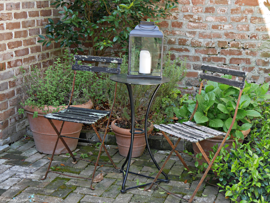 Cafe table and chairs in garden corner @FanningSparks
