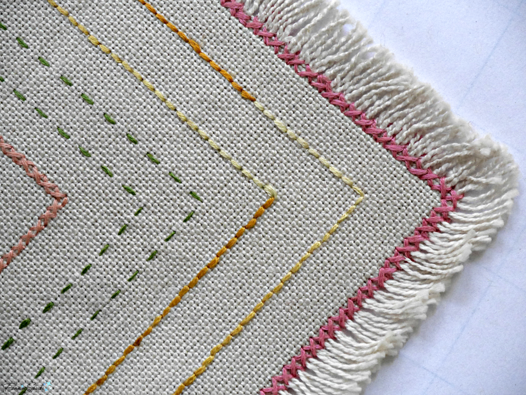 Beginner embroidery sampler showing closeup of cross and running stitches. @FanningSparks