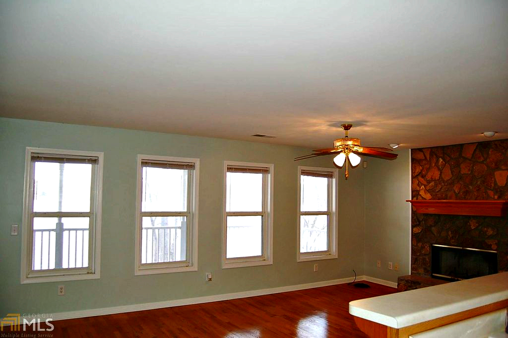 Living room showing window wall. @FanningSparks