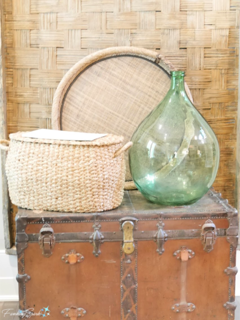 Vignette of Vintage Suitcase, Woven Basket, Tray and Wall Hanging with Green Glass Bottle.   @FanningSparks